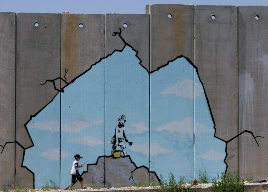 bansky-opening-the-apartheid-wall-in-palestine